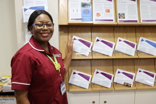 Nurse standing by patient information